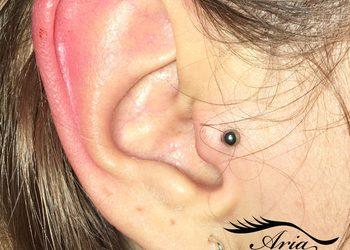 AriaVisage Atelier Urody - przekłucie chrząstki ucha (tragus)